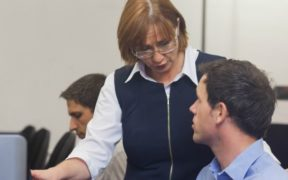 Teacher talking to a student