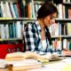 female student studying in library