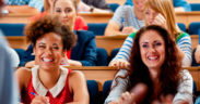 College students laughing during a lecture